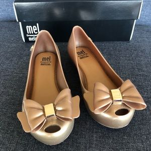 Melissa Girls gold bow shoes size 12